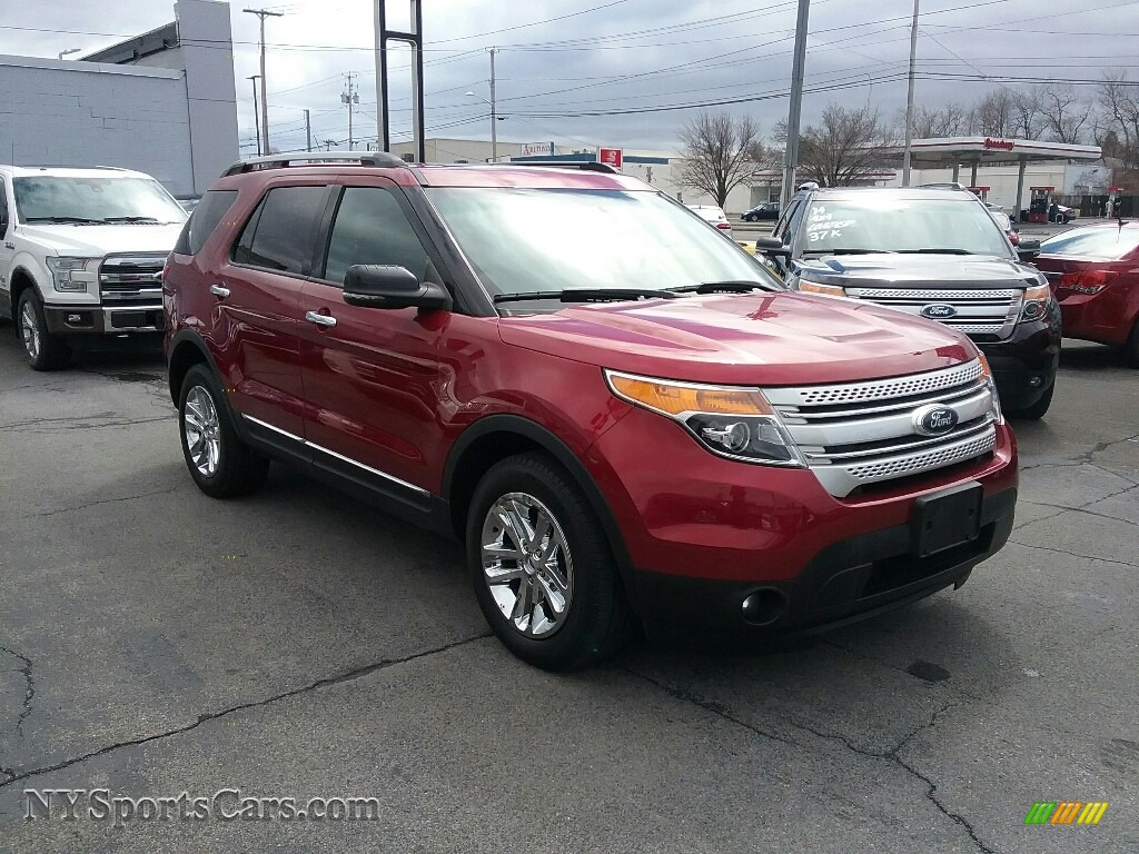 Ruby Red / Charcoal Black Ford Explorer XLT 4WD