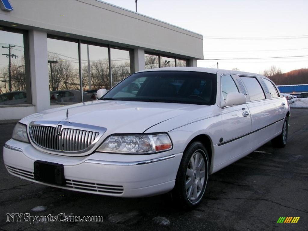 2003 town car limousine vibrant white black photo 1