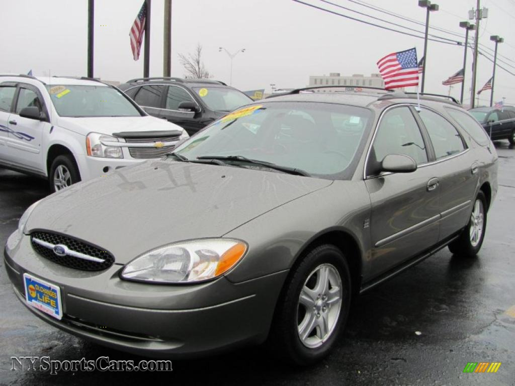 Spruce green metallic medium parchment ford taurus sel wagon