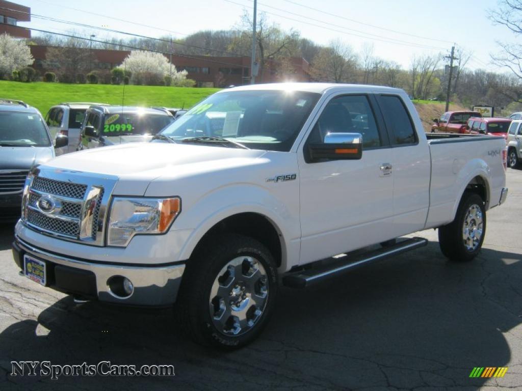 White platinum metallic tri coat black ford f150 lariat supercab 4x4