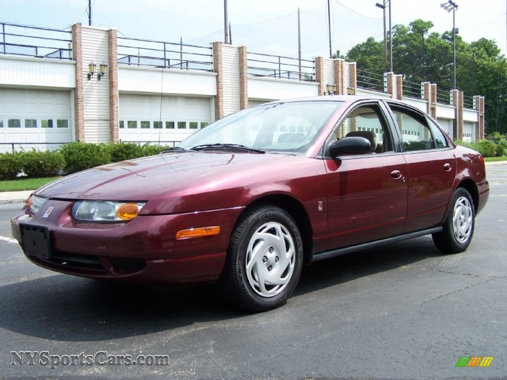 Cranberry tan saturn s series sl2 sedan