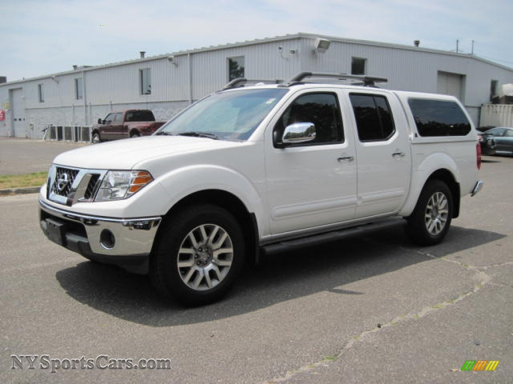 2009 nissan frontier le crew cab 4x4 in avalanche white 427927 cars for. Black Bedroom Furniture Sets. Home Design Ideas