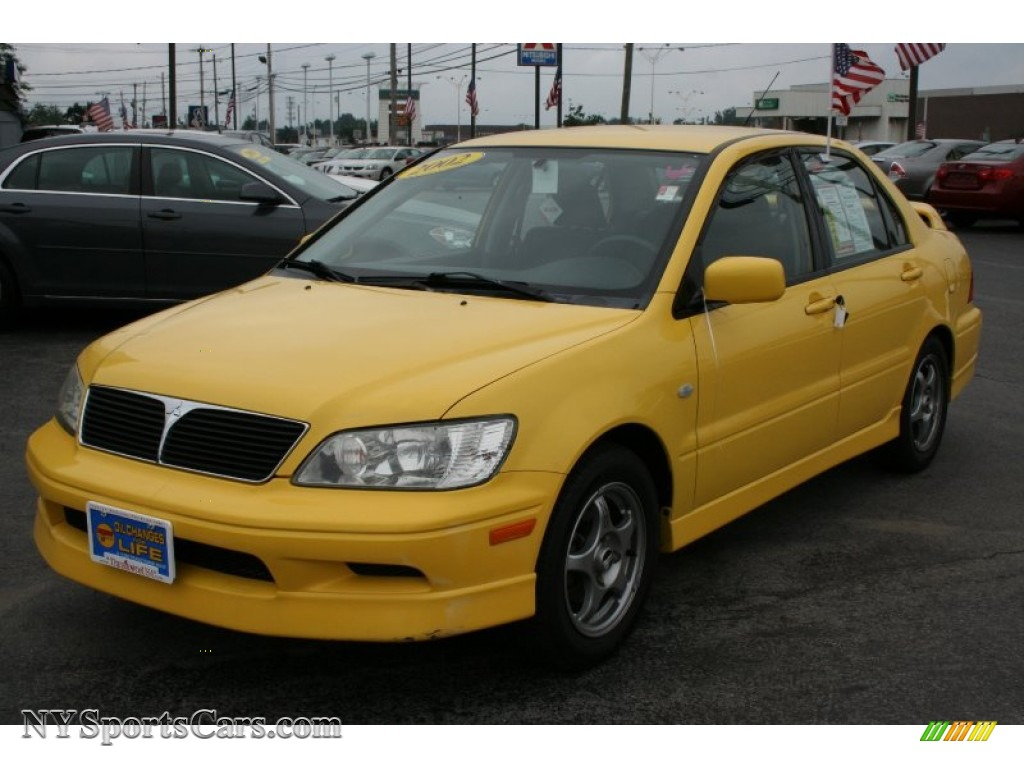 2002 mitsubishi lancer oz rally in lightning yellow 076421 cars for sale. Black Bedroom Furniture Sets. Home Design Ideas