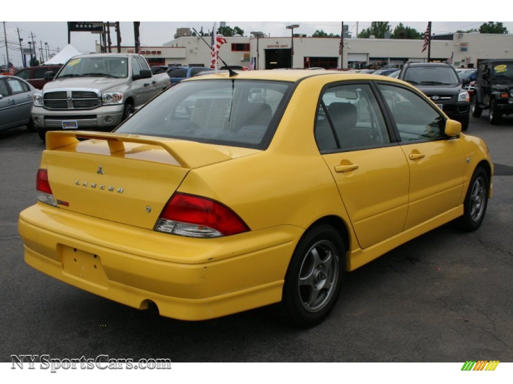 2002 mitsubishi lancer oz rally in lightning yellow photo. Black Bedroom Furniture Sets. Home Design Ideas