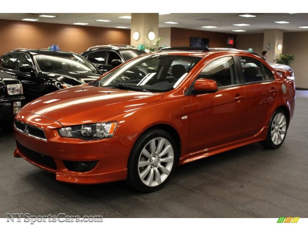 Sport Cars For Sale >> 2009 Mitsubishi Lancer GTS in Rotor Glow Orange Metallic - 019497 | NYSportsCars.com - Cars for ...