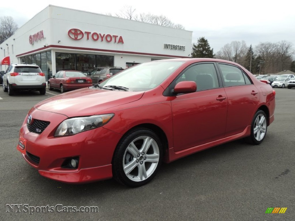 2009 toyota corolla xrs in barcelona red metallic 027682. Black Bedroom Furniture Sets. Home Design Ideas