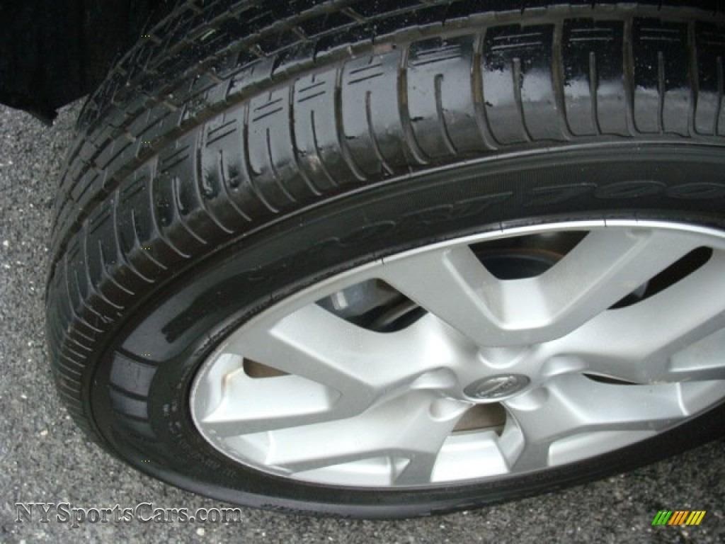 2011 Rogue SV AWD - Black Amethyst / Black photo #29